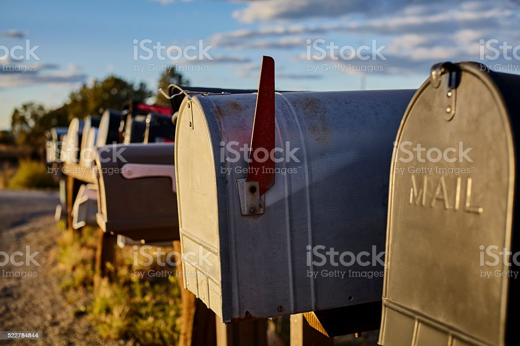 Rural Mailboxes with US Flag in Distance stock photo