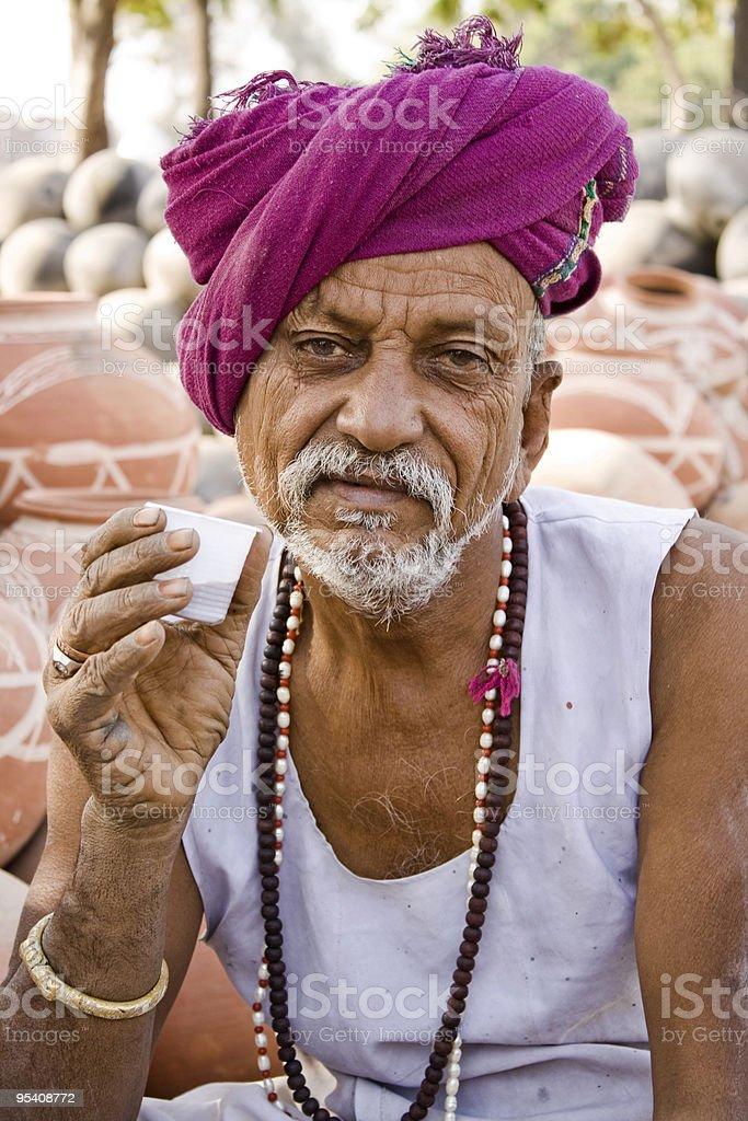 Rural Man Taking Tea stock photo