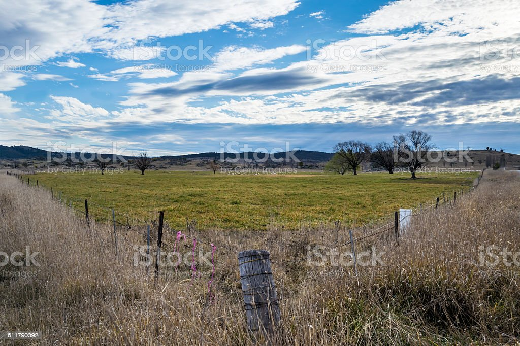 Rural property with fenceline in foreground stock photo