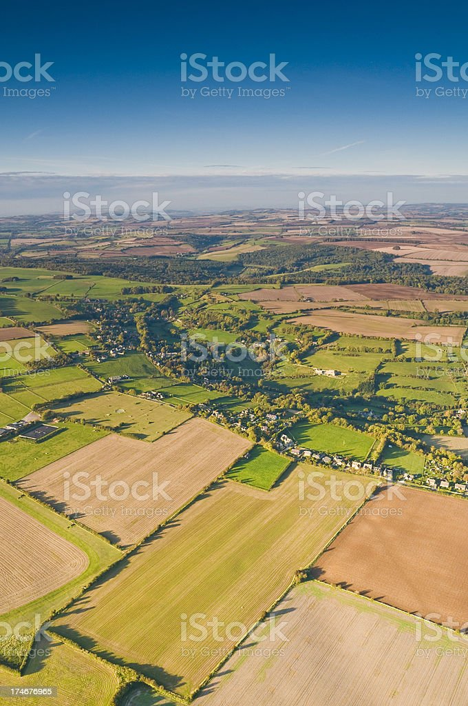 Rural quilt patchwork farmland quiet villages aerial vista royalty-free stock photo