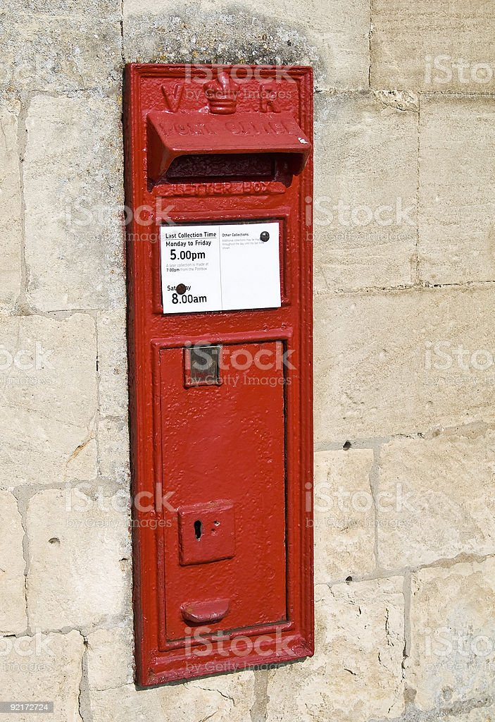 Rural Red Post Box in the Wall stock photo