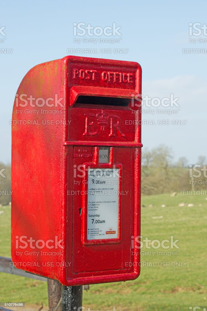 Rural red postbox in England stock photo