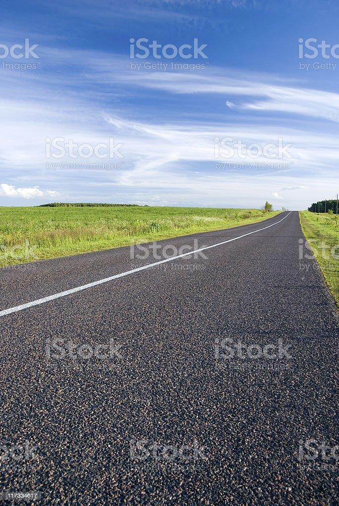 rural road and cloudy sky stock photo
