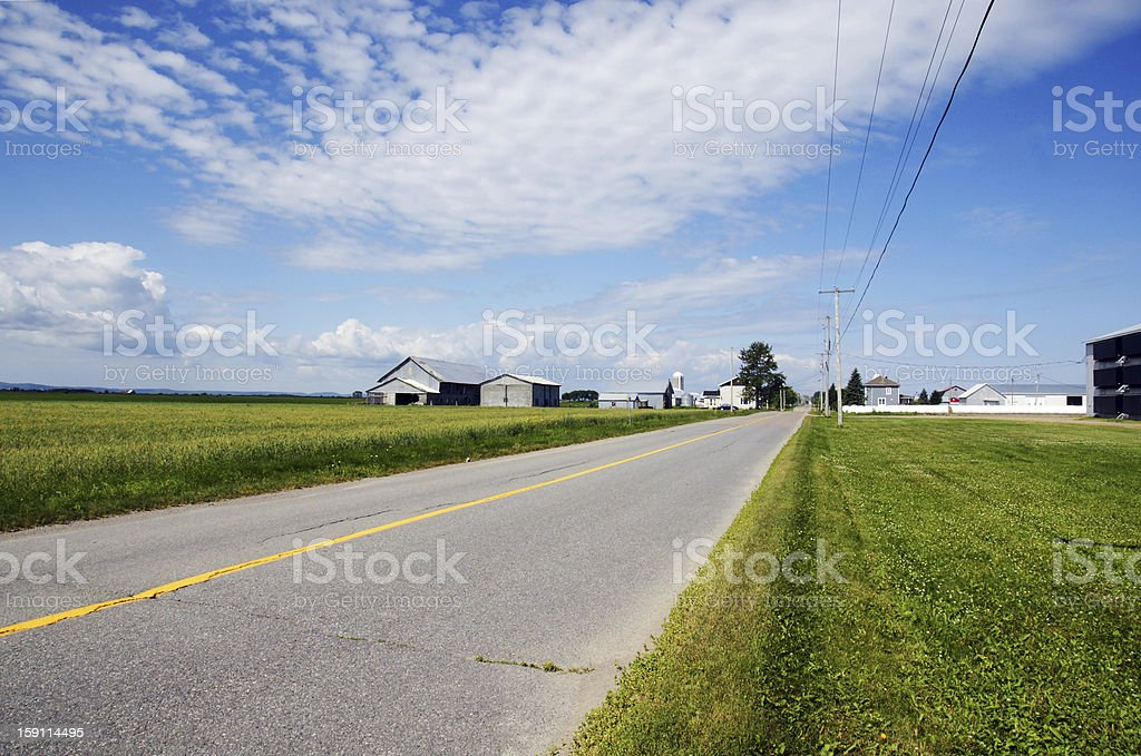 Rural road and farms royalty-free stock photo