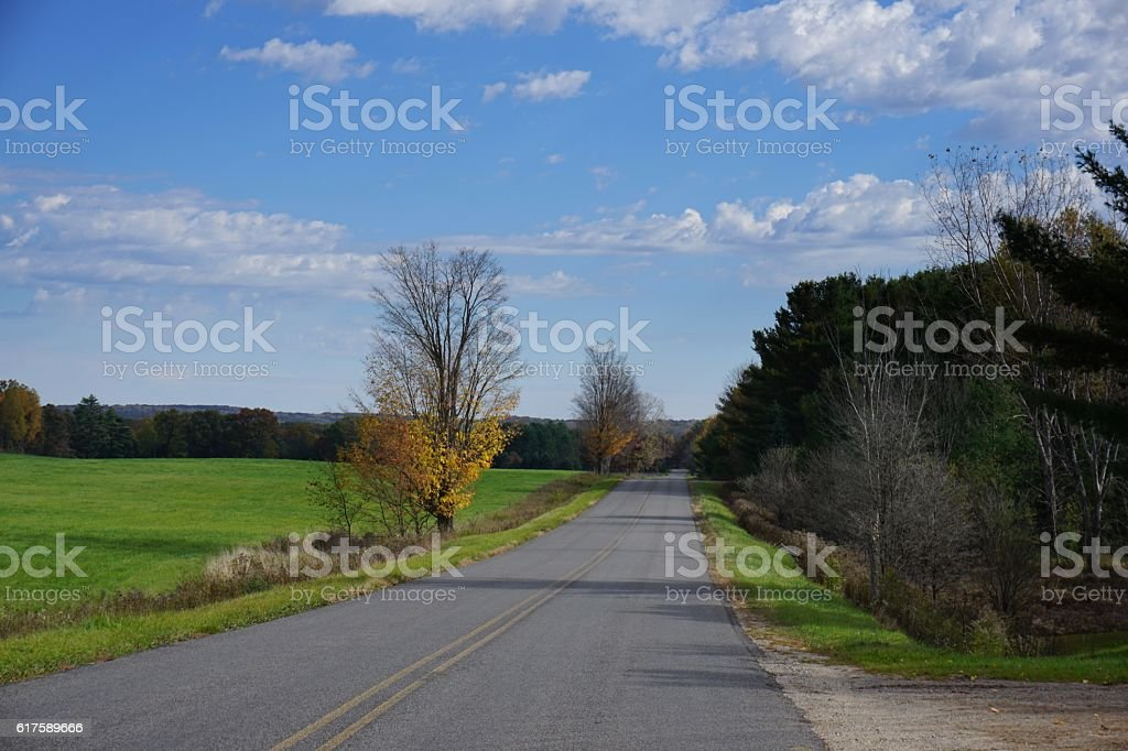 Rural road during autumn stock photo