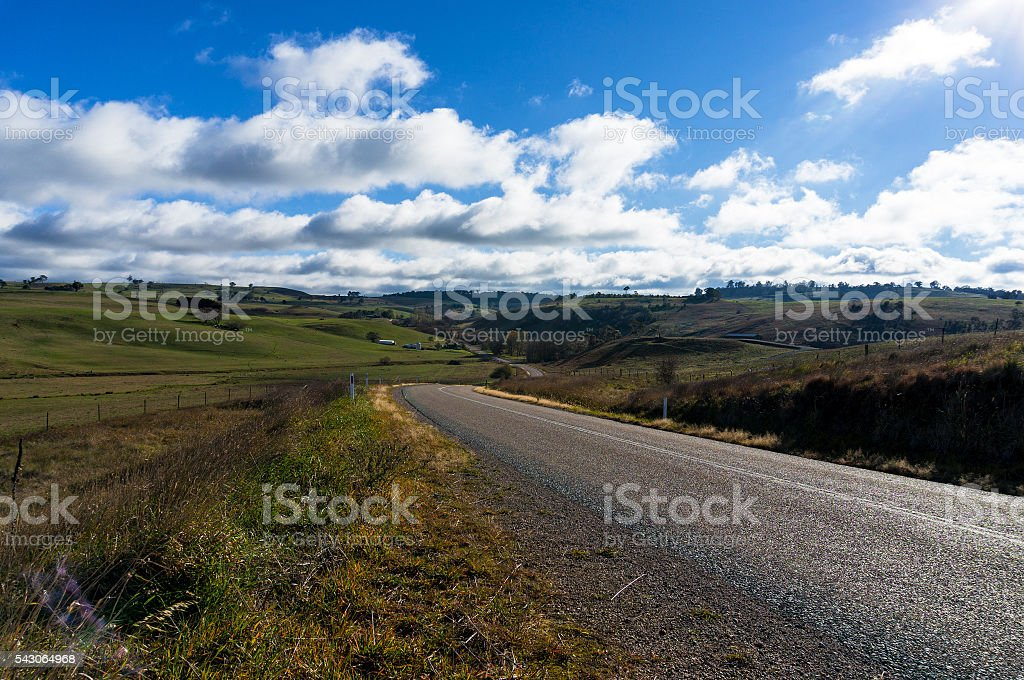 Rural road in Australian outback stock photo