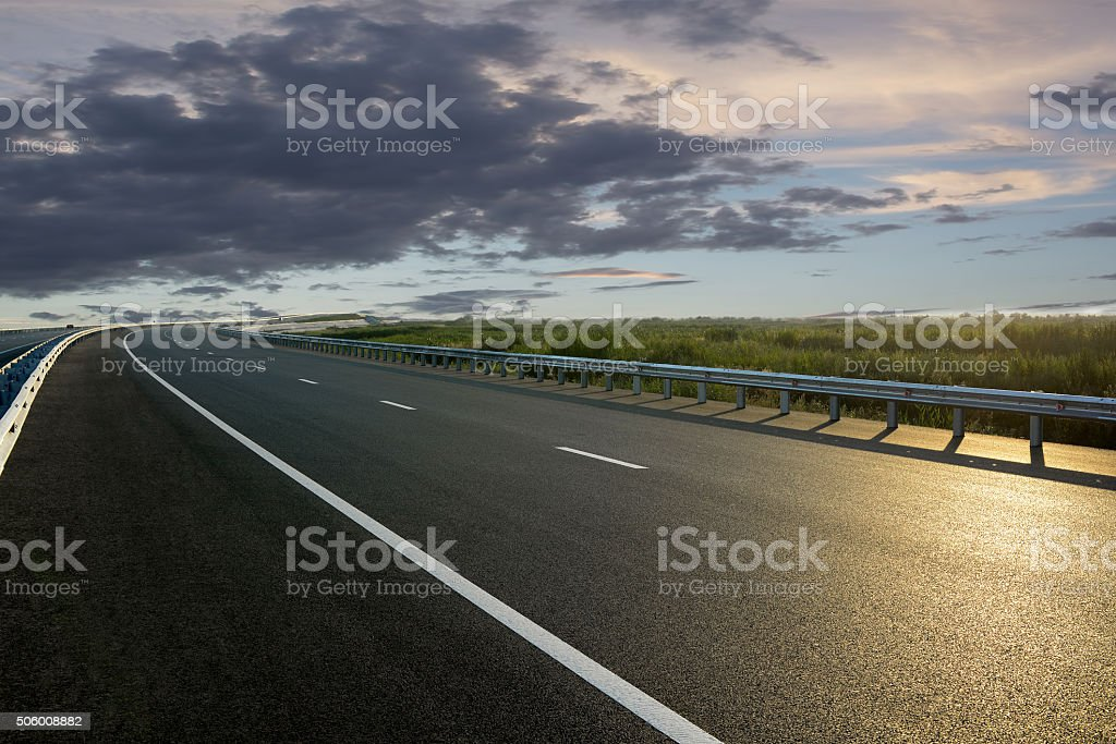 Rural road in the sunset stock photo
