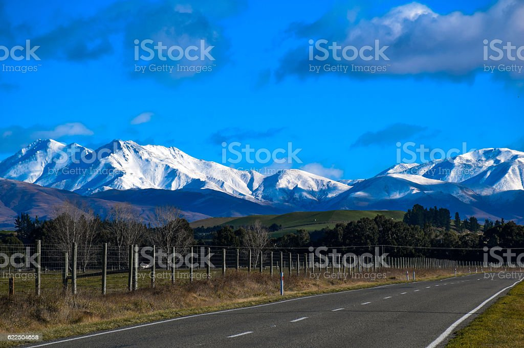 Rural road of New Zealand with covered snow mountain royalty-free stock photo