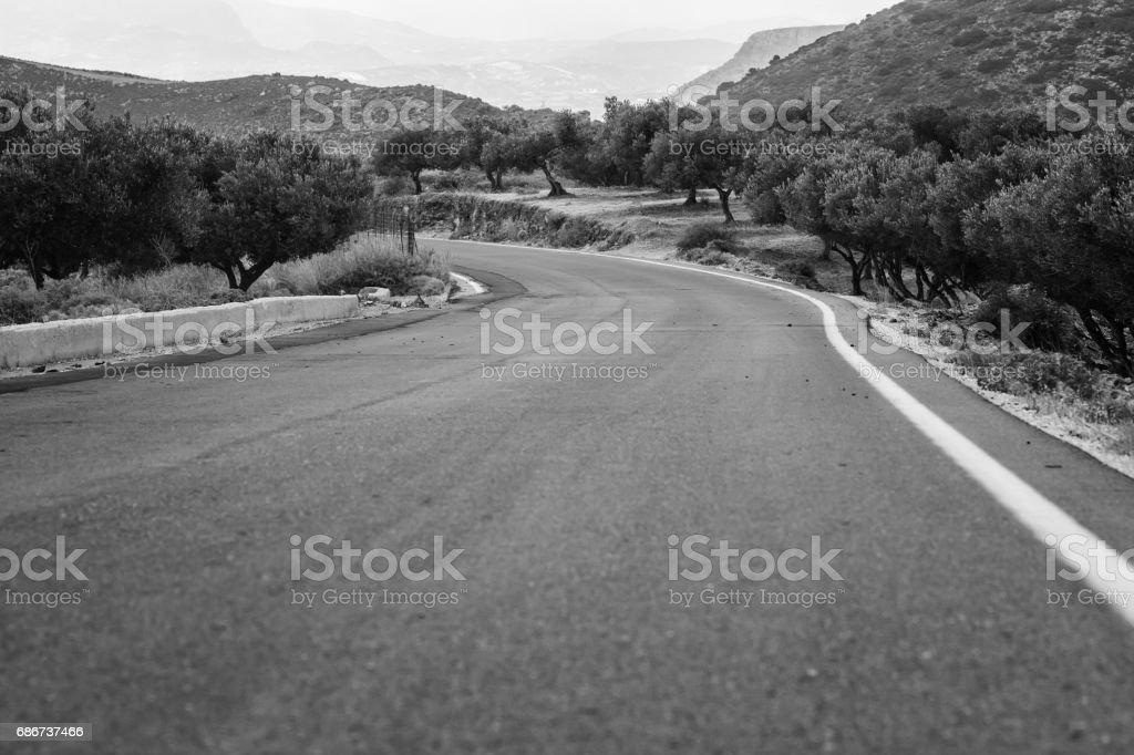 Rural road on Crete Island in b&w, Greece stock photo