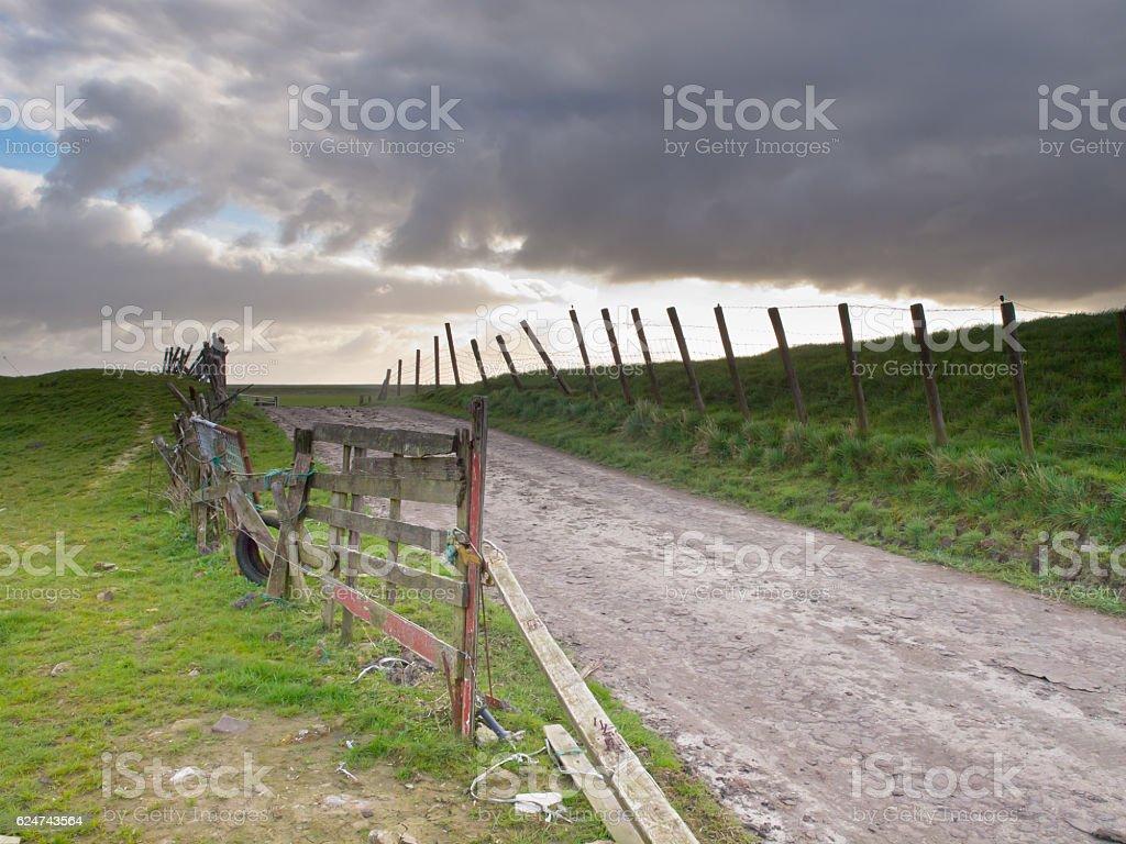 Rural road over a dutch dike stock photo