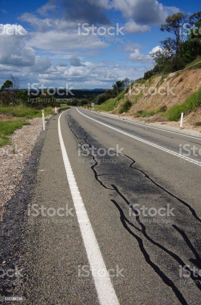rural road that has tar sealed repairs done royalty-free stock photo