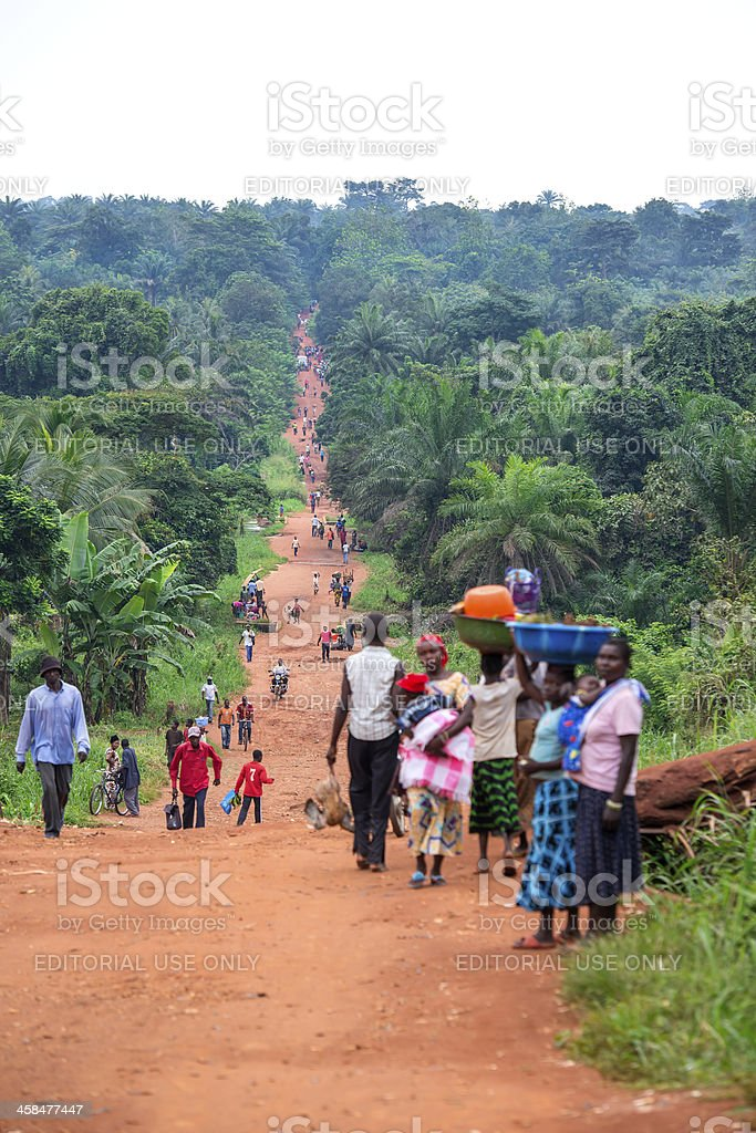 Rural Road with a lot of pedestrians, DR Congo stock photo
