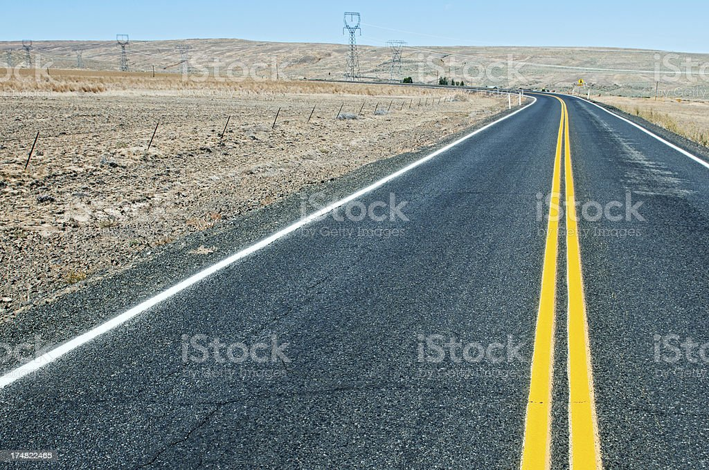 Rural road with newly painted yellow lines in Washington state royalty-free stock photo