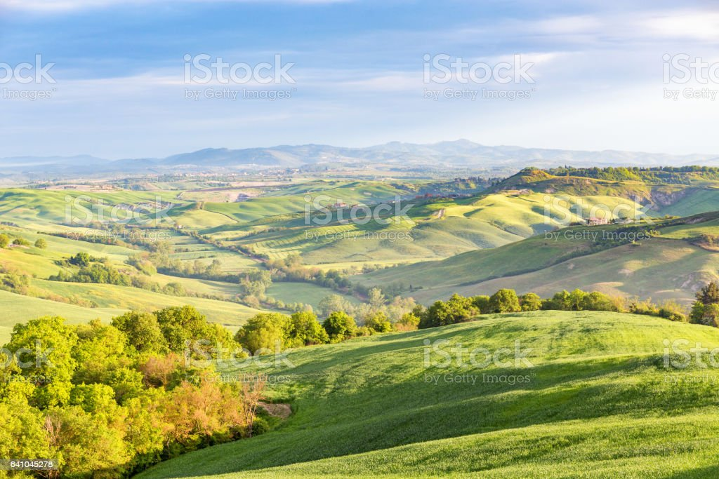 Rural rolling landscape view in a valley in Italy stock photo