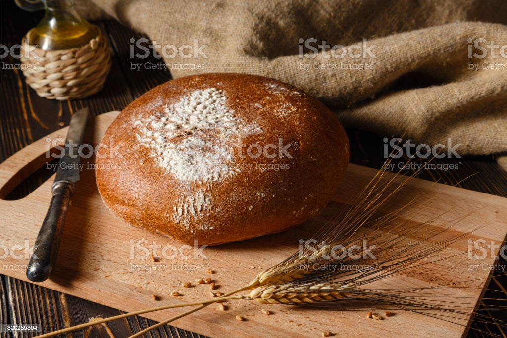 Rural rye bread lies on a table stock photo