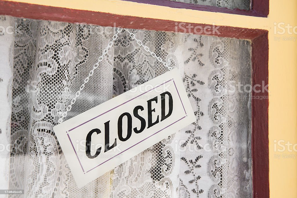 Rural Small Business with Closed Sign Hanging in Window royalty-free stock photo