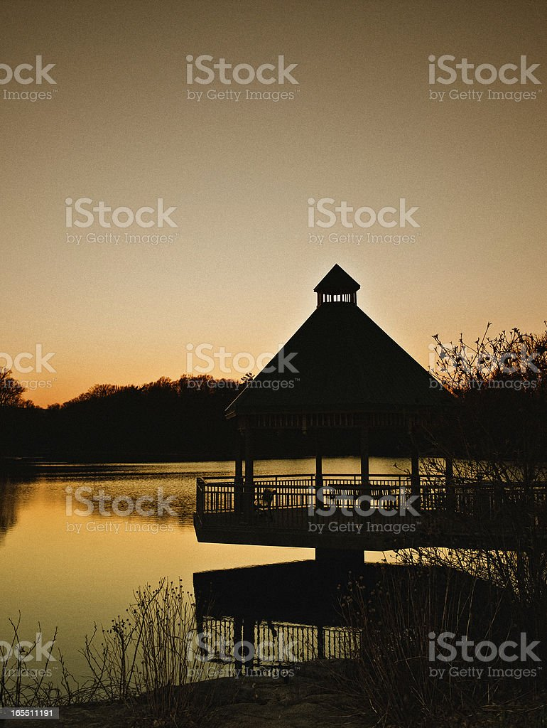 Rural Sunset Over Pond Gazebo stock photo