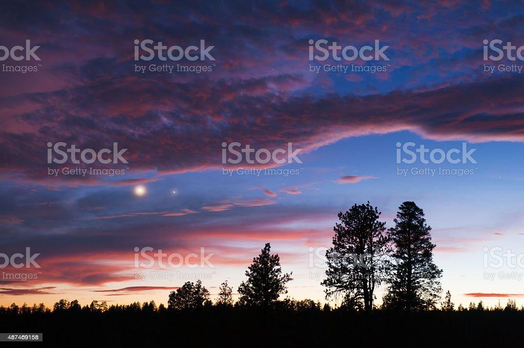 Rural sunset showcasing Venus and Jupiter stock photo