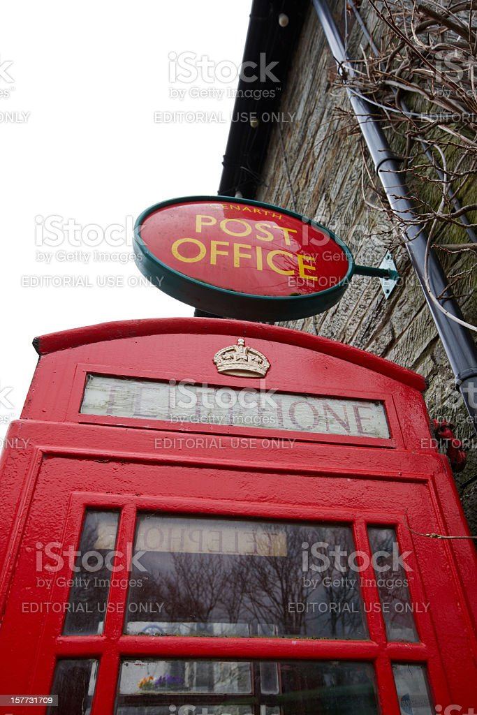 Rural telephone box and post office sign royalty-free stock photo