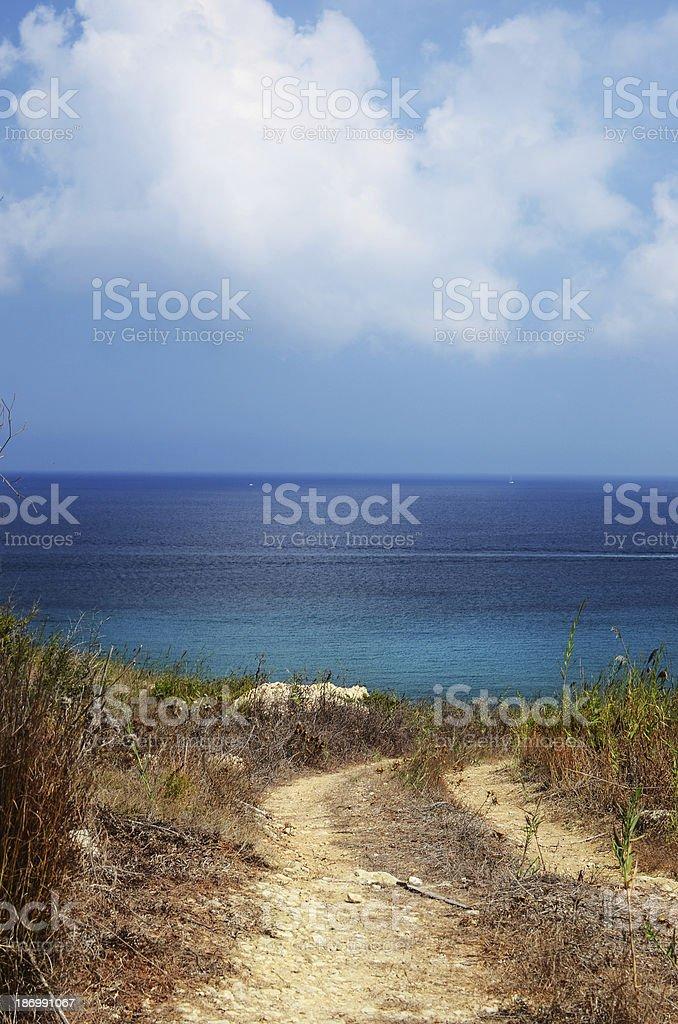 Rural walkway to the Mediterranean sea in Malta royalty-free stock photo