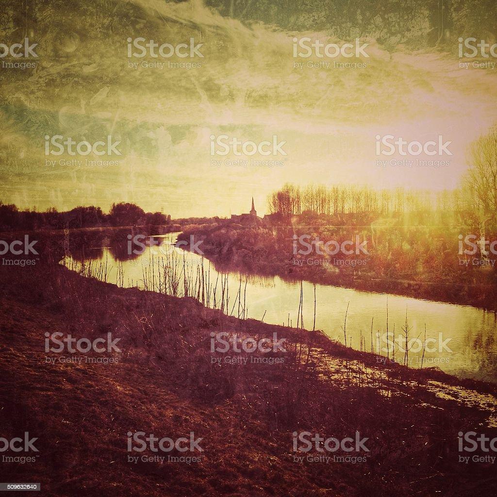 Rural winter landscape with  river at sunset near Mechelen,Belgium stock photo