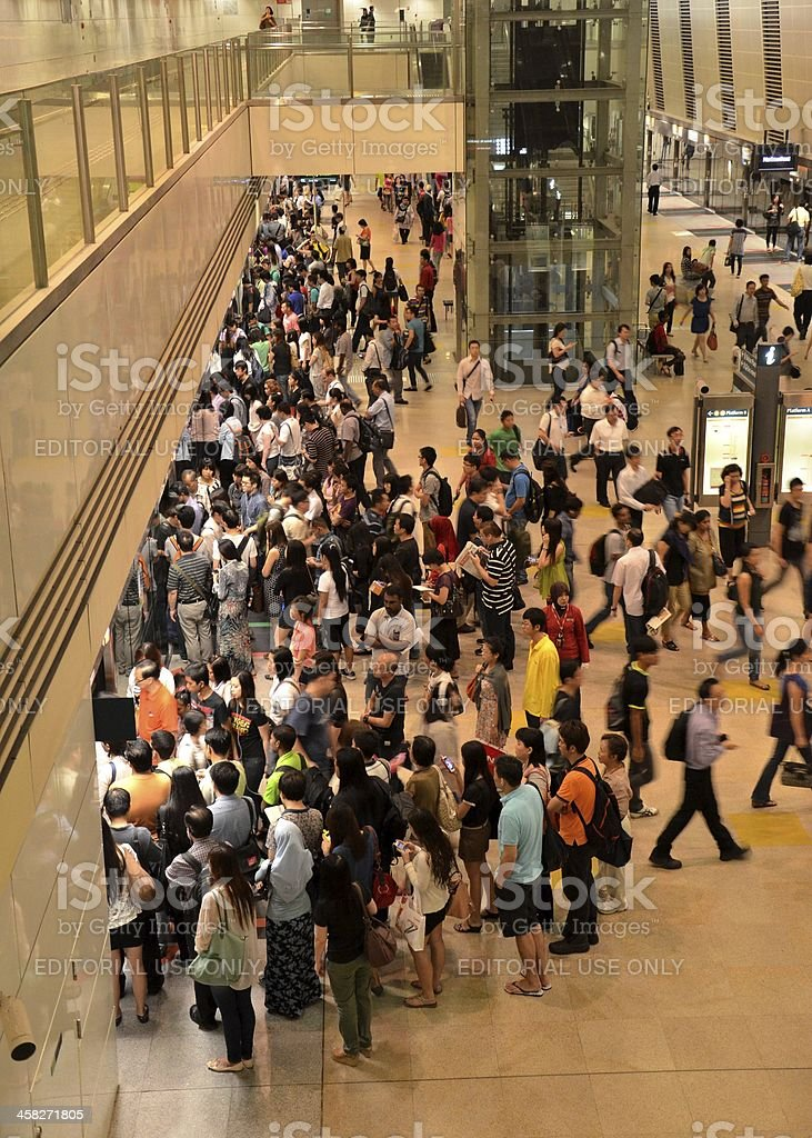 Rush hour crowd waits to enter subway train in Singapore royalty-free stock photo