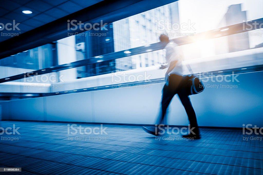 rush hour passengers at walkway stock photo