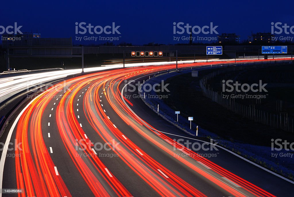 rush hour traffic at night on multiple lane highway royalty-free stock photo