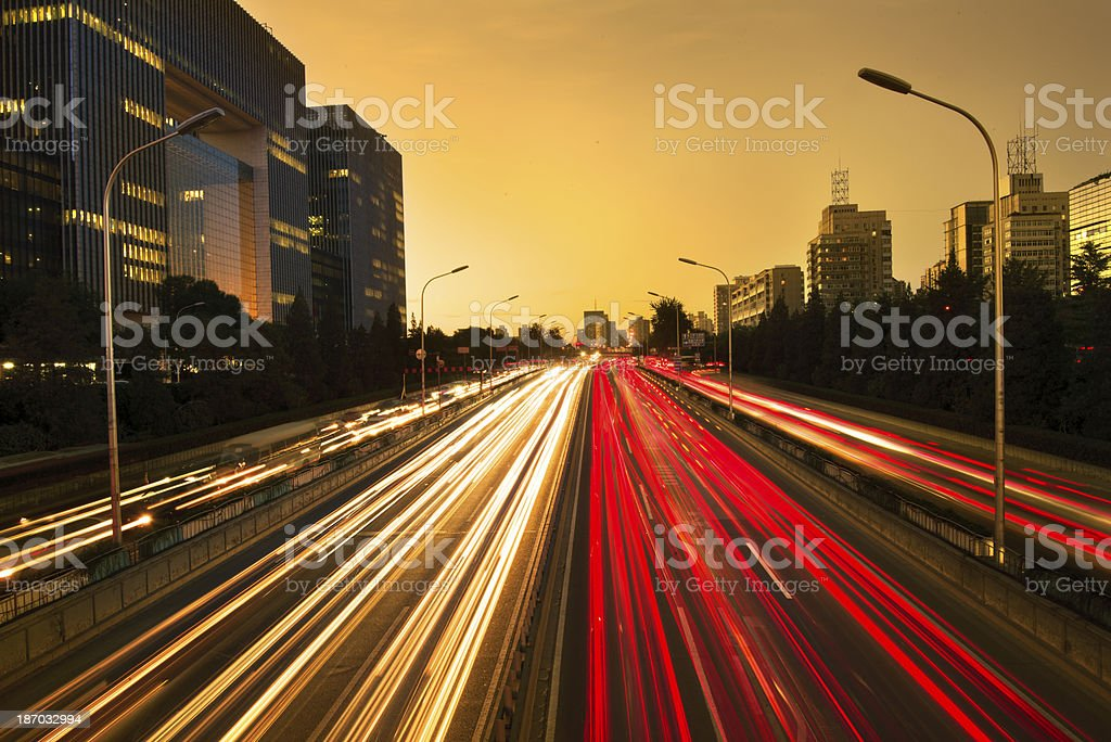 Rush hour traffic at night on multiple lane highway stock photo