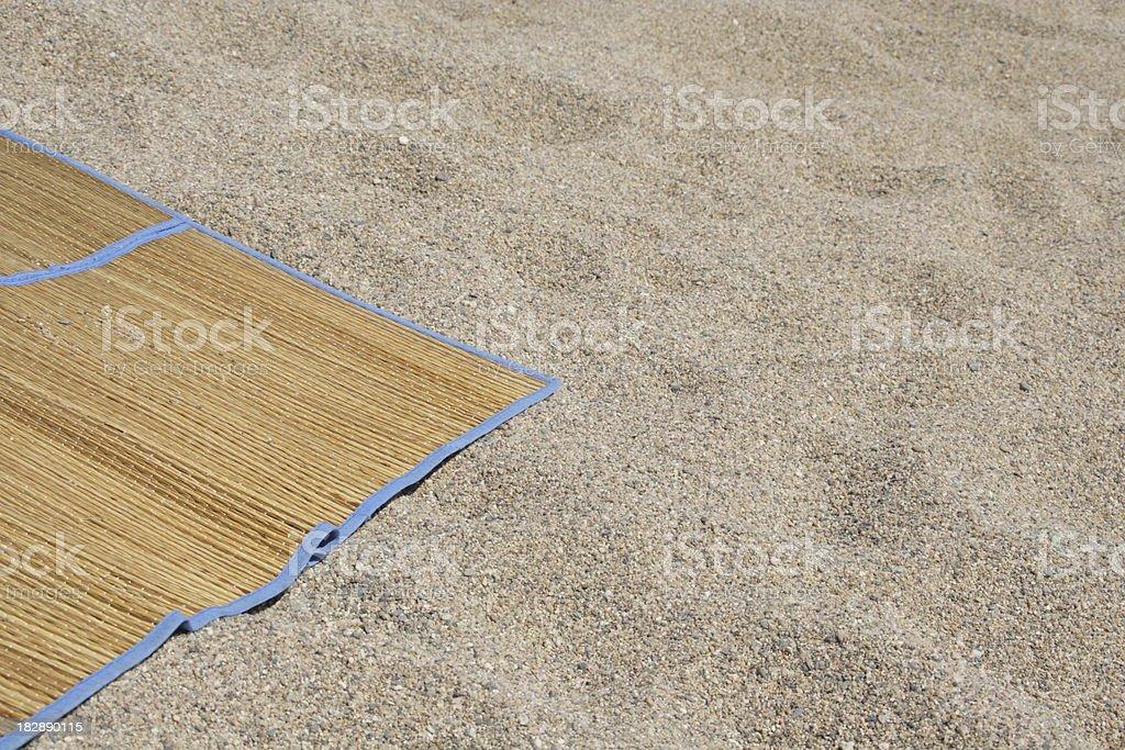 Rush mat on sand stock photo