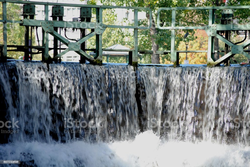 Rushing water through canal lock stock photo