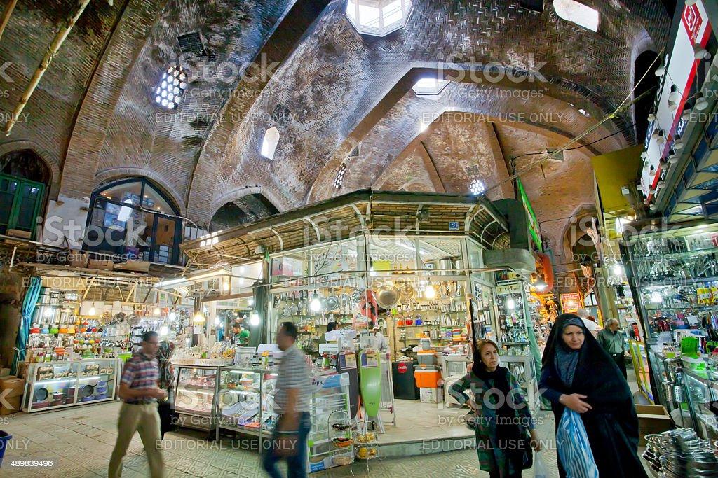 Rushing women inside the old bazaar stock photo