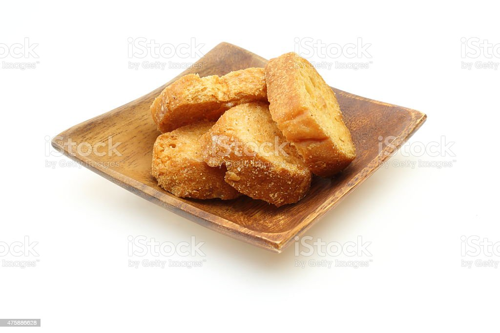 Rusk on a wooden plate stock photo