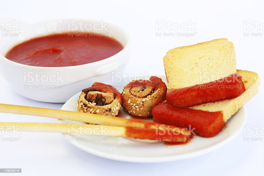 Rusks with sesame seeds, bread sticks and sauce royalty-free stock photo
