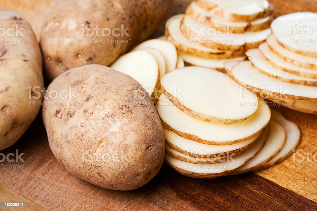 Russet Potatoes - Whole and Sliced stock photo