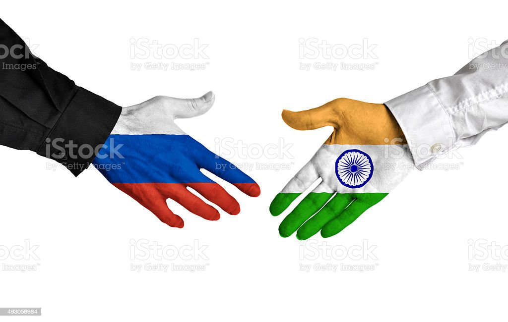 Russia and India leaders shaking hands on a deal agreement stock photo