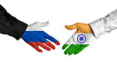 Russia and India leaders shaking hands on a deal agreement