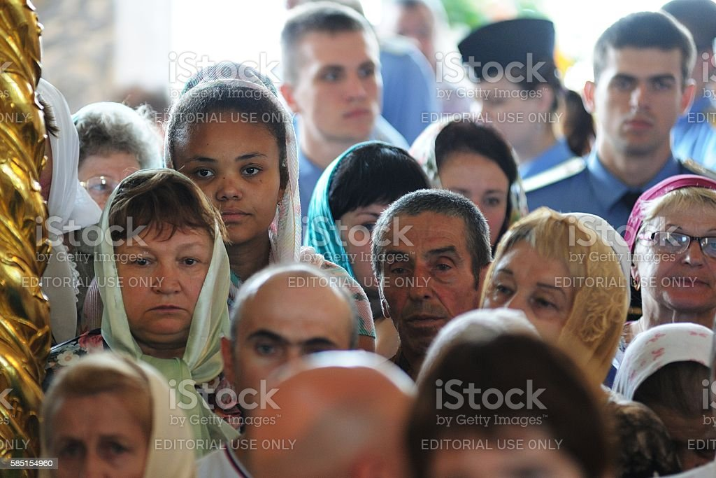 Russia baptism anniversary Divine Liturgy. African girl among Russian parisioners stock photo