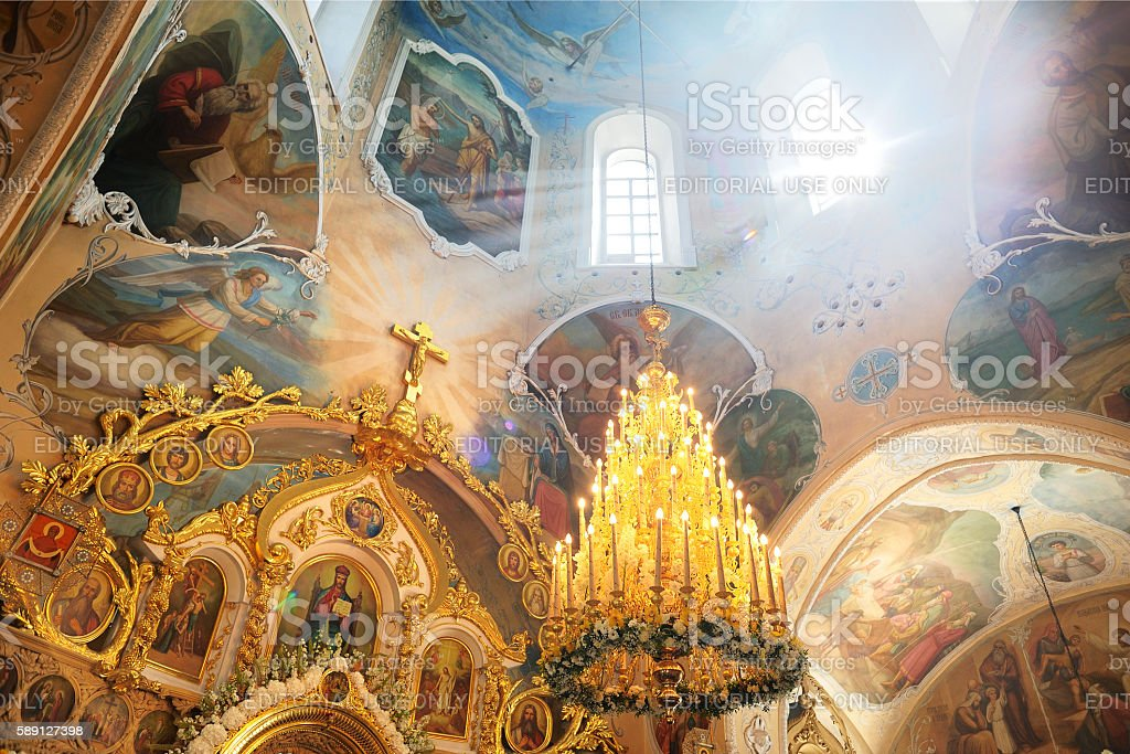 Russia baptism anniversary Divine Liturgy. Sun rays coming throuth window stock photo