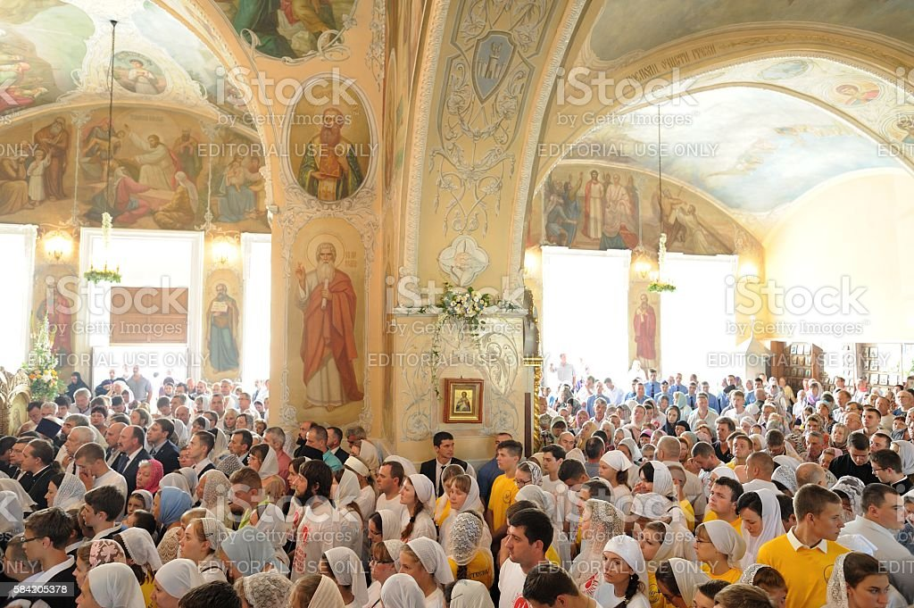 Russia baptism anniversary Divine Lutirgy. Crowd of parisioners waiting stock photo