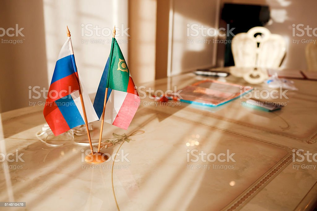 Russia Flag and the Republic of Khakassia on table in stock photo