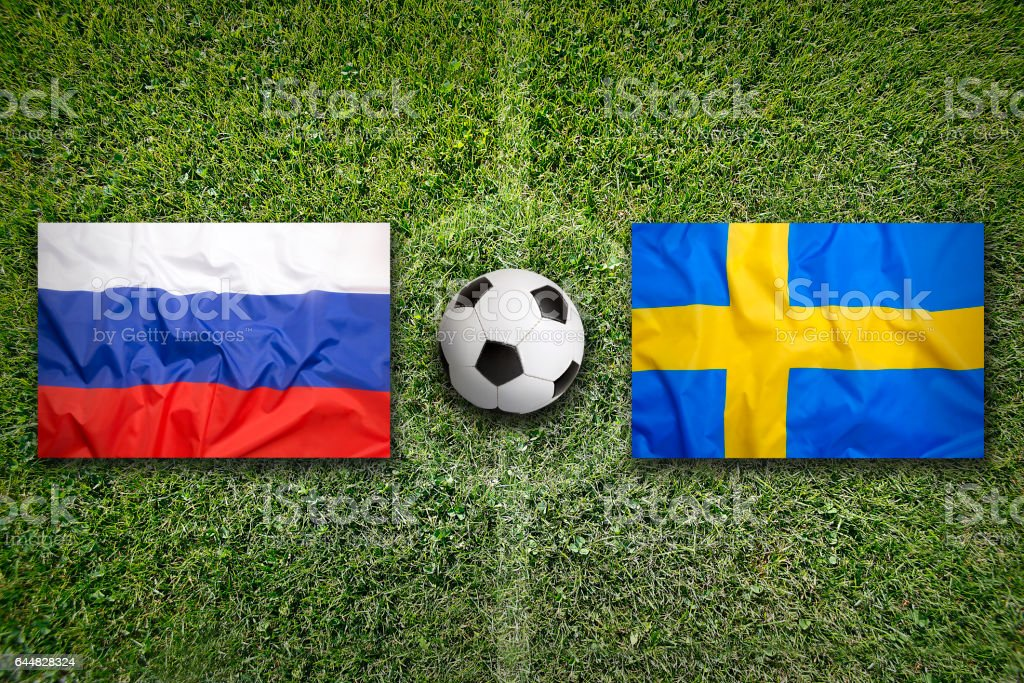Russia vs. Sweden flags on soccer field stock photo