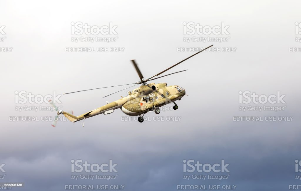 Russian army Mi-8 helicopter in action against cloudy sky stock photo