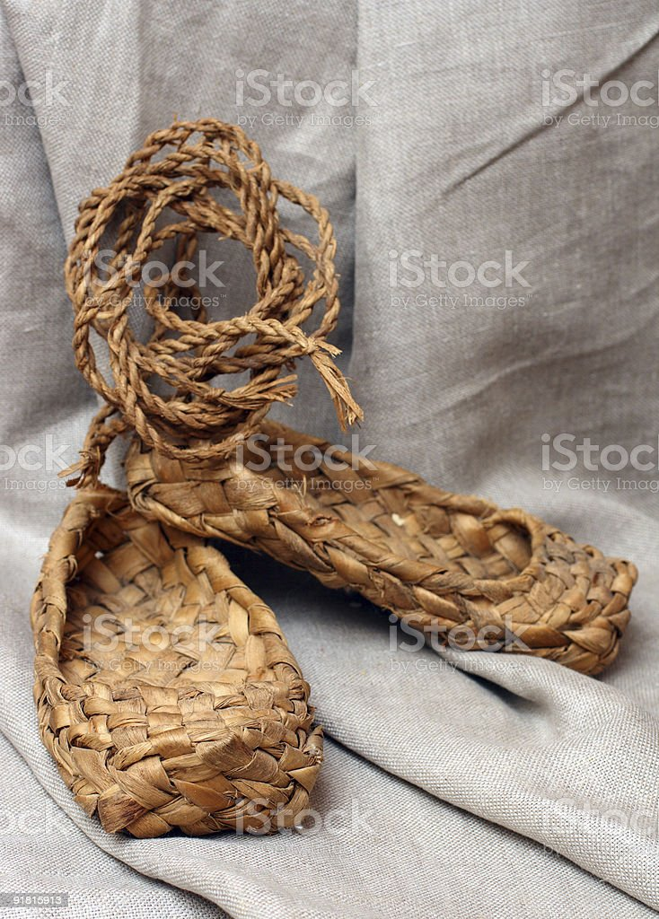 russian bast shoes on canvas stock photo