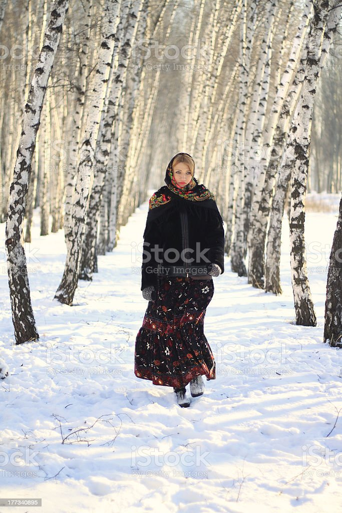 Russian beauty in the winter birch forest royalty-free stock photo