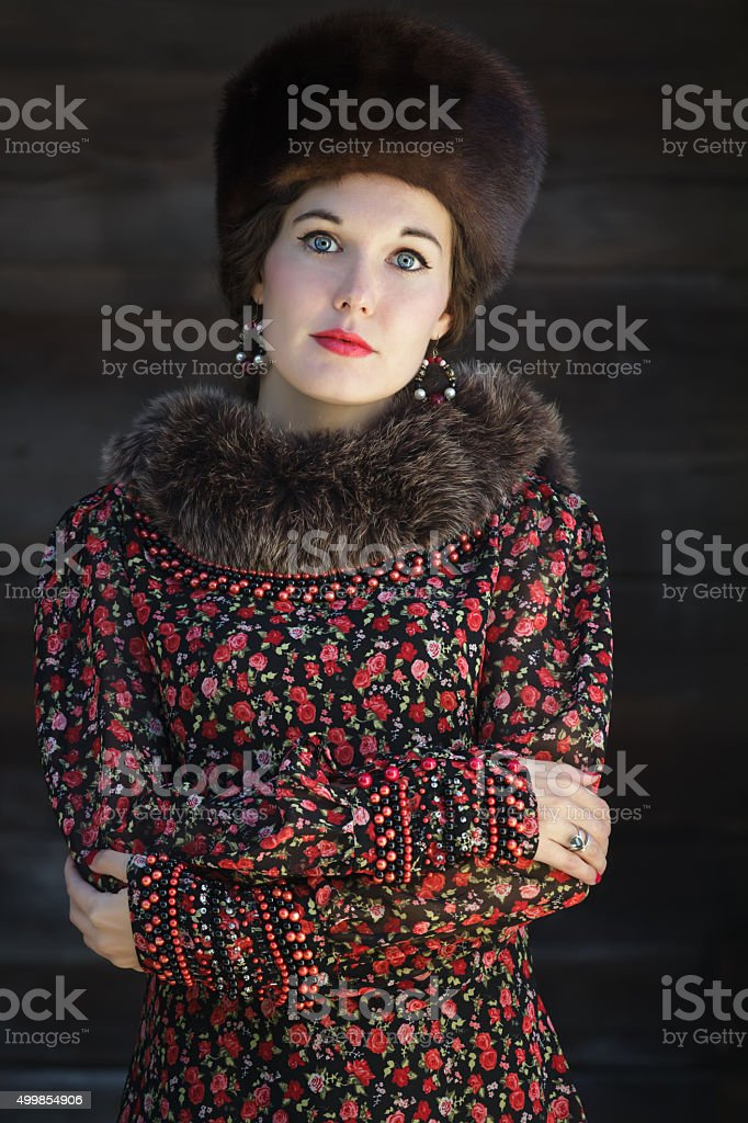 Russian beauty in traditional medieval style clothing with crossed arms stock photo
