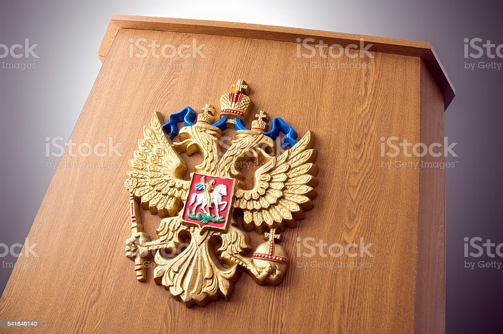Russian coat of arms on the podium stock photo