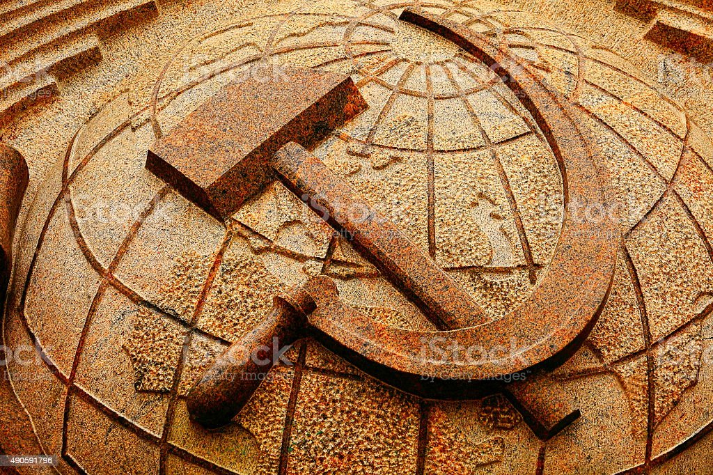 Russian communist Hammer and Sickle marble, Soviet Union symbol stock photo