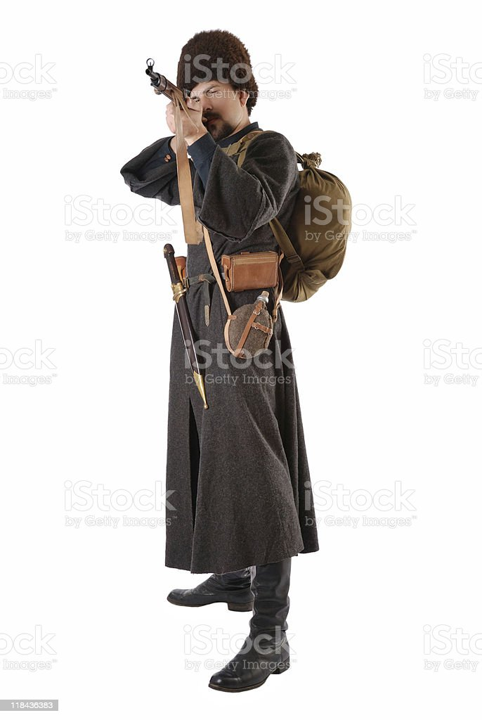 Russian Cossack points a rifle. The living history. stock photo
