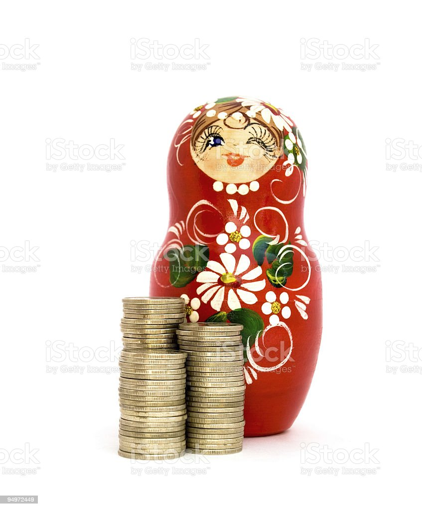 Russian Doll and Piles of coins royalty-free stock photo